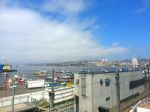 View from the parkade ramp at the Ibis Hotel in Valparaiso during the daytime.